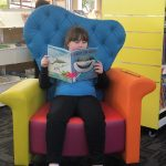 Anderson enjoying silent reading in the newly renovated library.